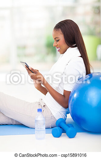 african American woman using tablet computer - csp15891016