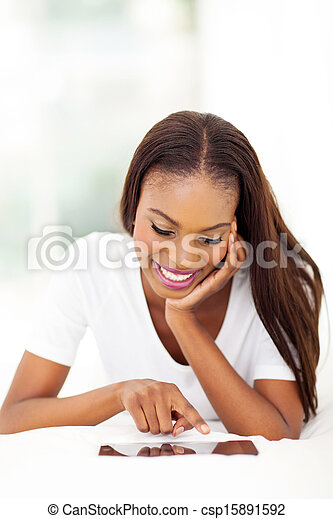 african american woman using tablet compter at home - csp15891592