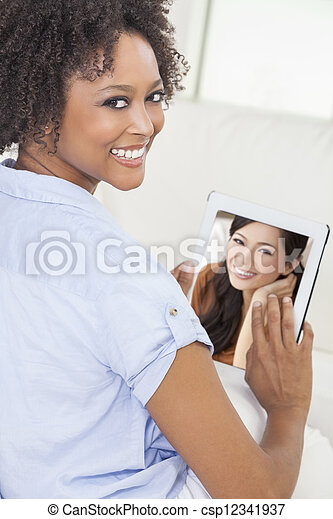 African American Woman Using Tablet Computer - csp12341937