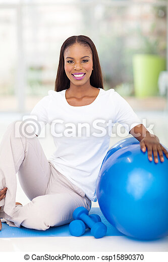 african american woman with exercise ball at home - csp15890370