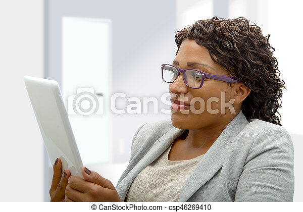 african american woman with eyeglasses and tablet computer - csp46269410