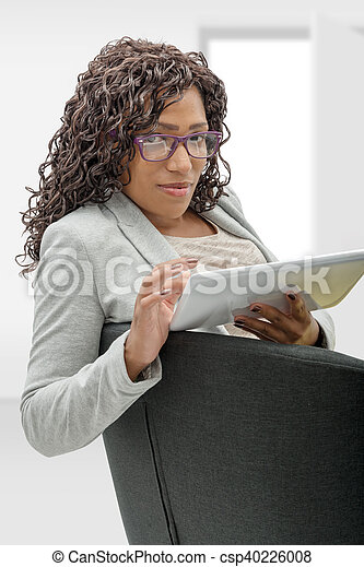 african american woman with eyeglasses and tablet computer - csp40226008