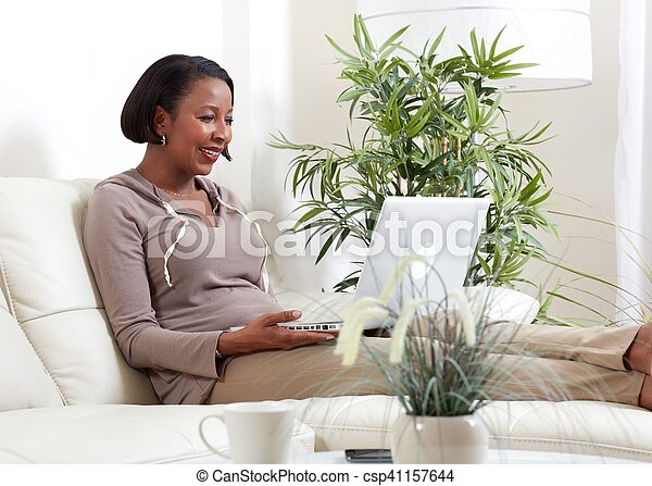 African-American woman with laptop. - csp41157644