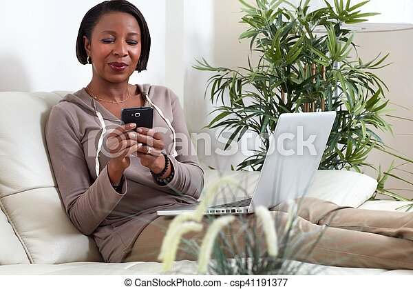 African-American woman with smartphone. - csp41191377