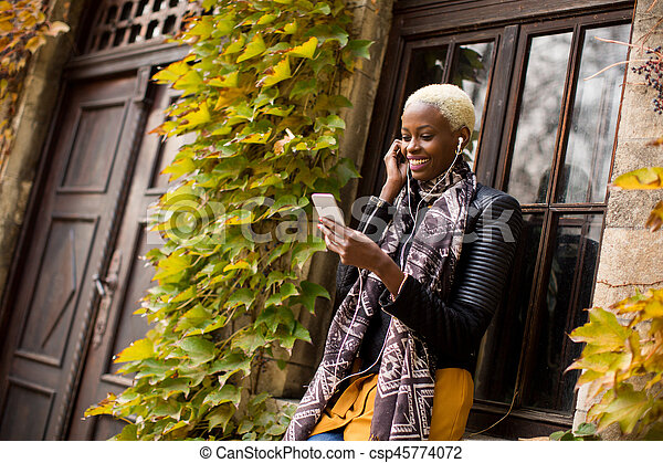 African american woman with smartphone outdoor - csp45774072