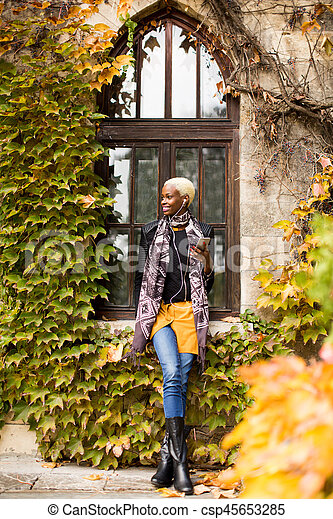 African american woman with smartphone outdoor - csp45653285