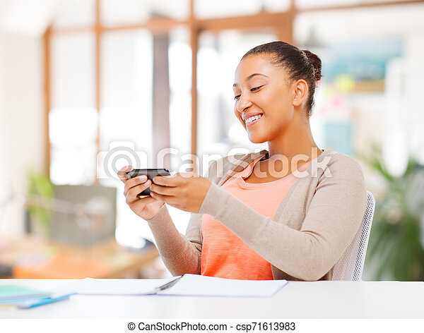 african american woman with smartphone - csp71613983