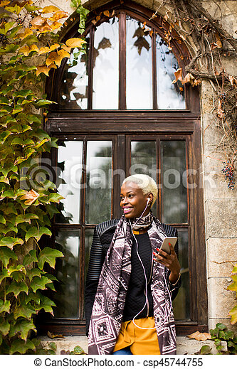 African american woman with smartphone outdoor - csp45744755