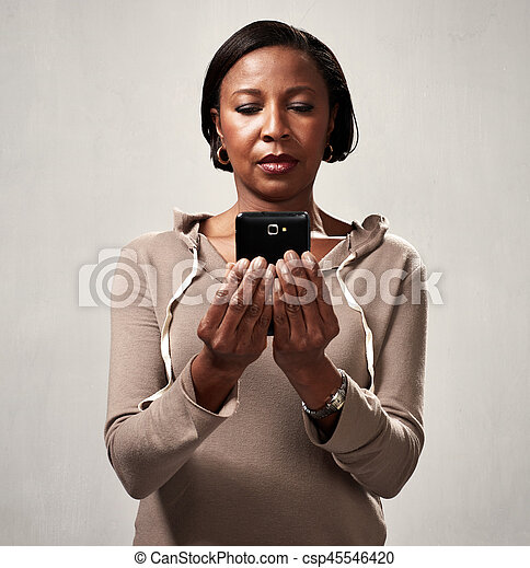 African american woman with smartphone - csp45546420