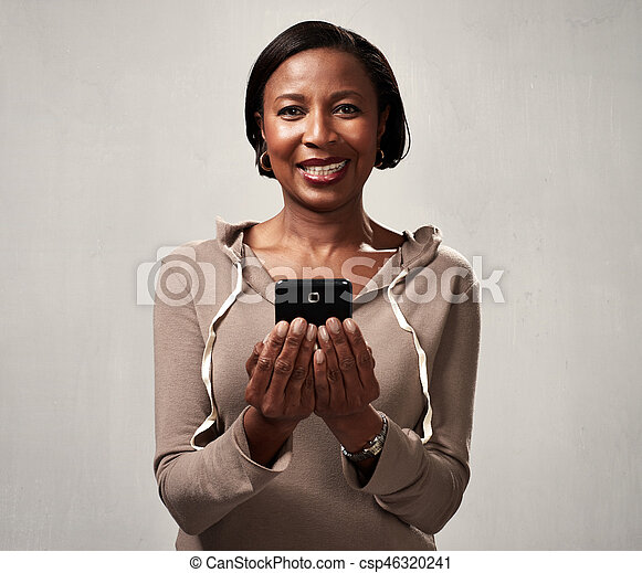 African american woman with smartphone - csp46320241