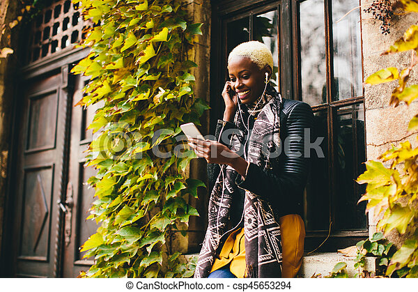 African american woman with smartphone outdoor - csp45653294