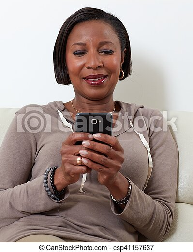African-American woman with smartphone. - csp41157637