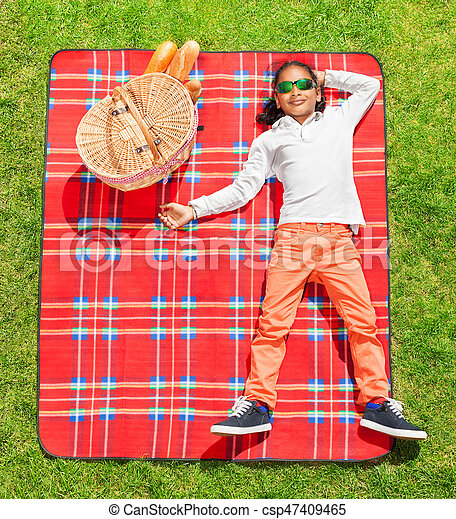 African boy in sunglasses relaxing on the picnic - csp47409465