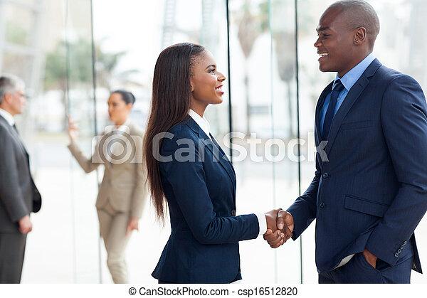african business people handshaking - csp16512820