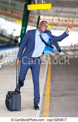 african businessman calling taxi at airport - csp13254617