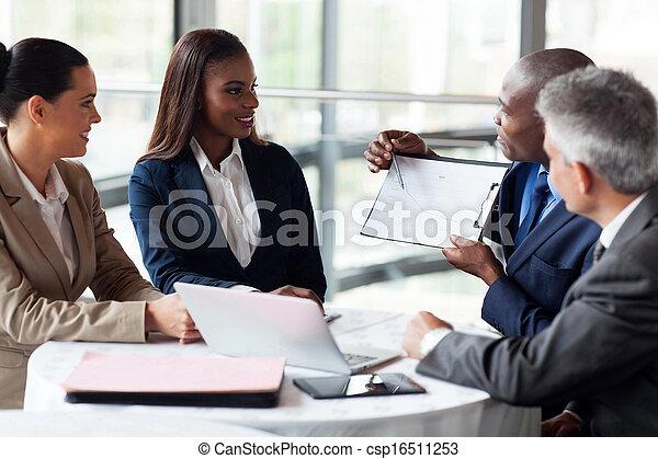 african businessman explaining sales graph to colleagues - csp16511253