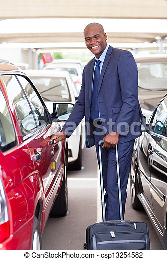 african businessman in airport parking lot - csp13254582