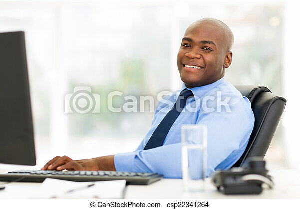 african businessman sitting in office looking at the camera - csp22341264