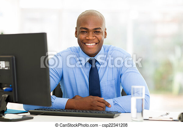 african businessman sitting in office - csp22341208