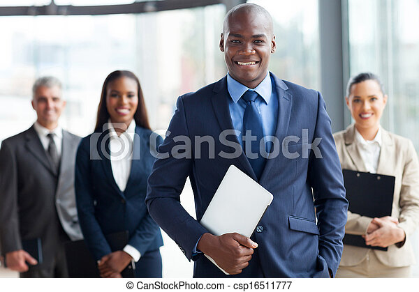 african businessman with group of businesspeople - csp16511777