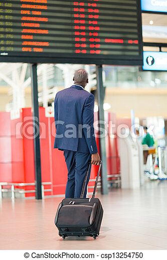 african businessman with luggage  - csp13254750