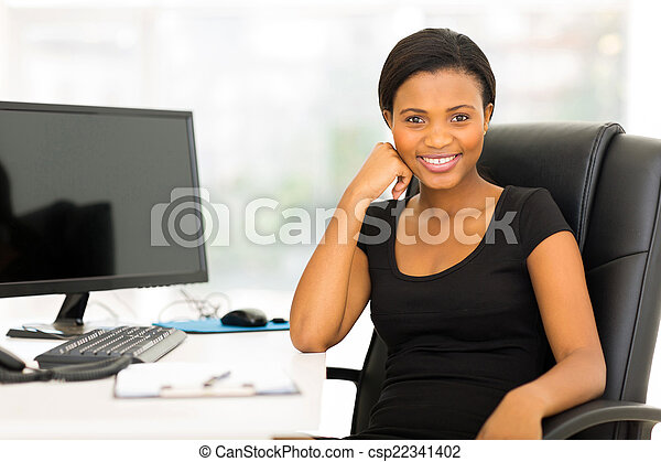 african businesswoman sitting in office - csp22341402