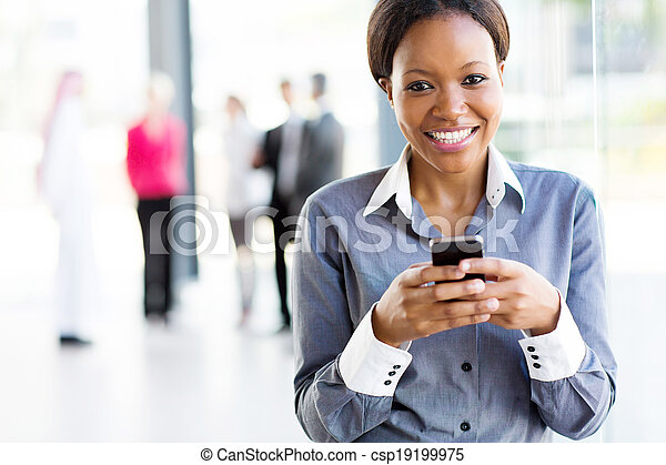 african businesswoman using smart phone - csp19199975