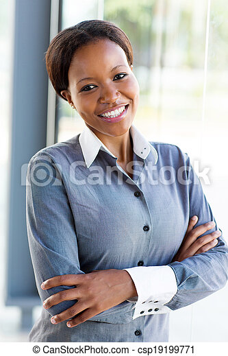 african businesswoman with arms folded - csp19199771
