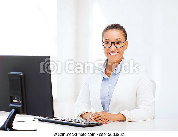 african businesswoman with computer in office - csp15883982