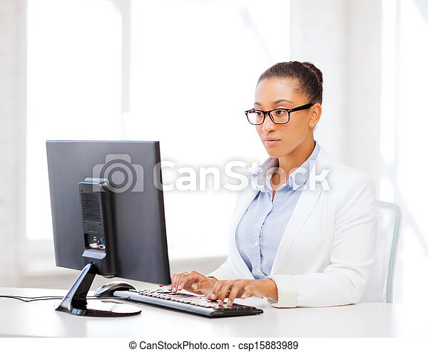 african businesswoman with computer in office - csp15883989