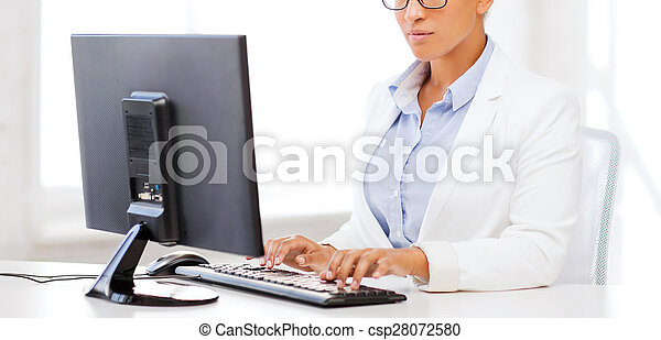 african businesswoman with computer in office - csp28072580