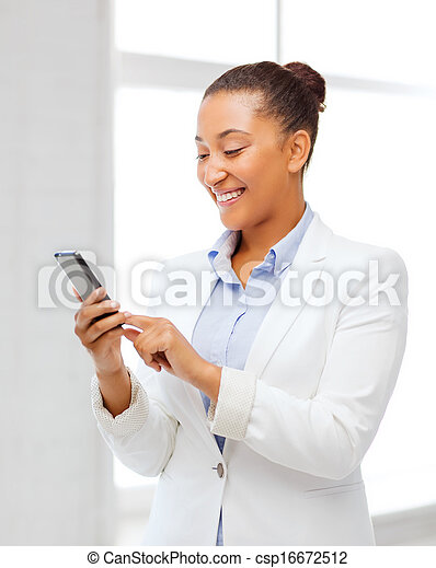 african businesswoman with smartphone in office - csp16672512