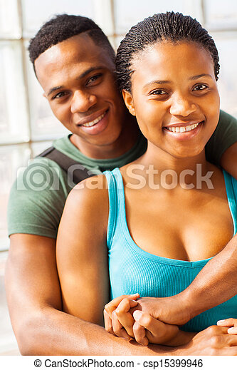 african college couple hugging - csp15399946