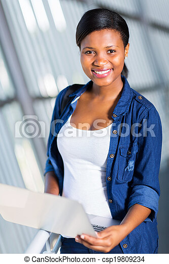 african college girl using laptop - csp19809234