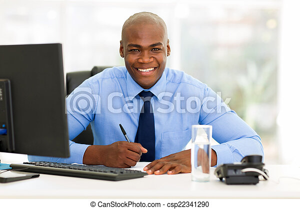 african corporate worker working in office - csp22341290