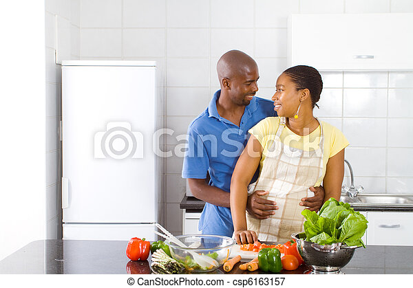 african couple hugging in kitchen - csp6163157