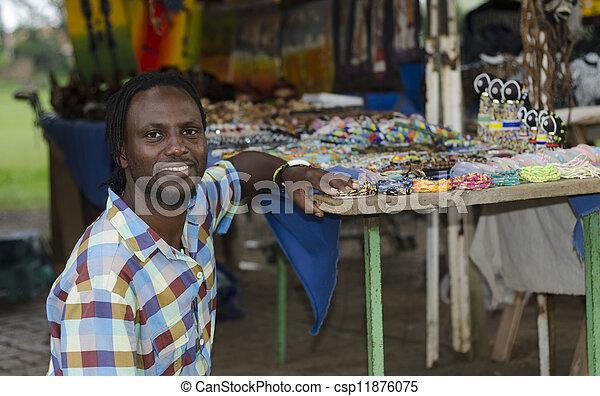 African curio salesman - csp11876075