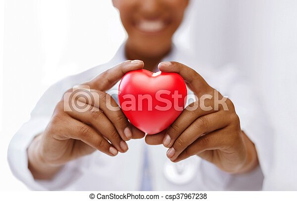 african female doctor with red heart - csp37967238