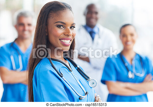 african female nurse with colleagues - csp16515313