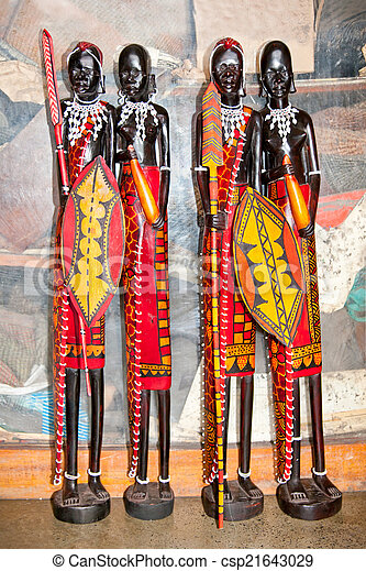 African handcraft dark wood carved people figures - csp21643029