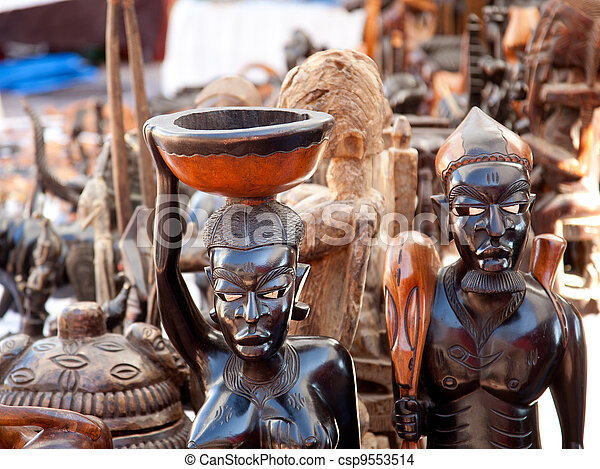 african handcraft dark wood carved figures - csp9553514