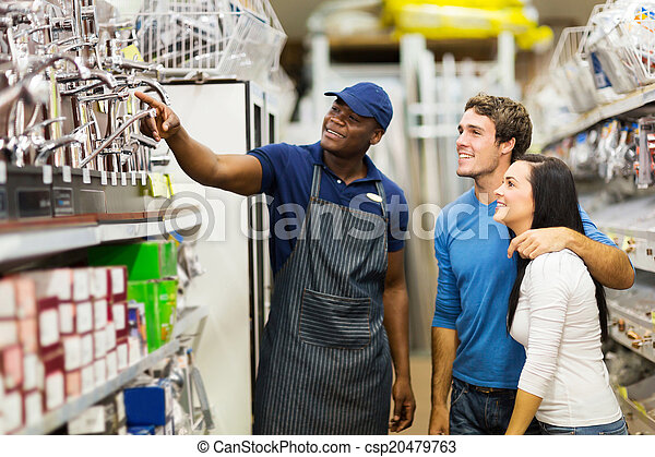african hardware store assistant helping customers - csp20479763