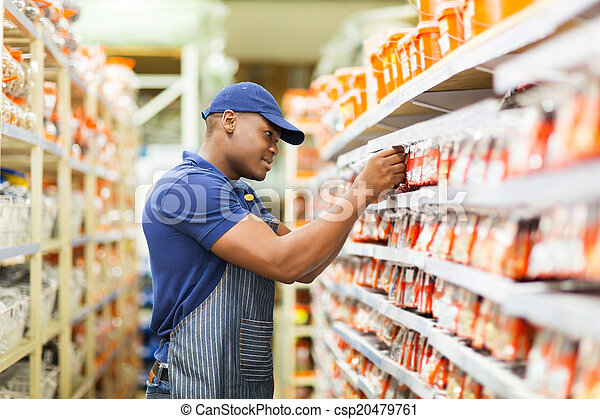 african hardware store worker working in the shop - csp20479761