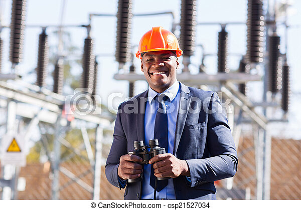 african industrial manager with binoculars - csp21527034