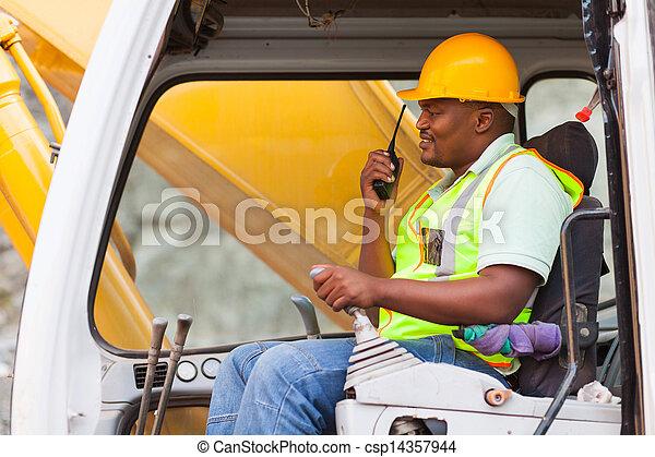 african industrial worker operating bulldozer - csp14357944