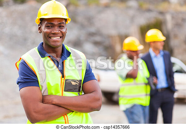 african industrial worker with arms folded - csp14357666