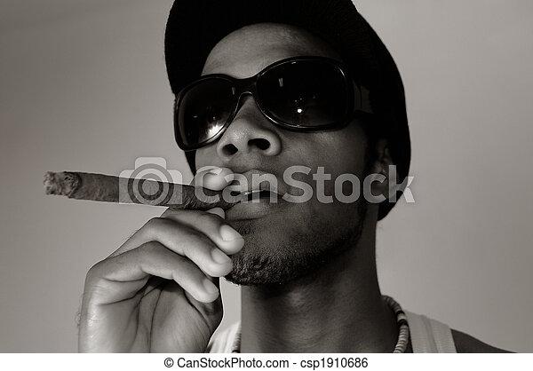 African man smoking cigar - csp1910686