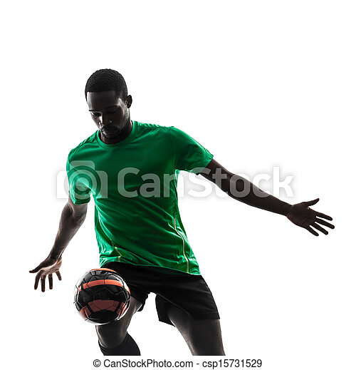 african man soccer player  juggling silhouette - csp15731529