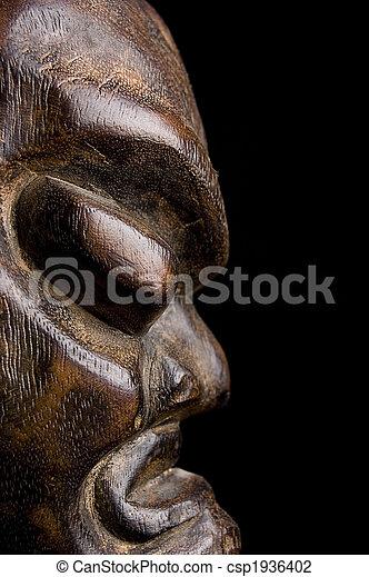 African mask over black background - csp1936402