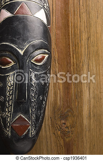 African mask over wooden background - csp1936401